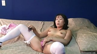 Adorable Asian mom got dressed up for the webcam masturbation